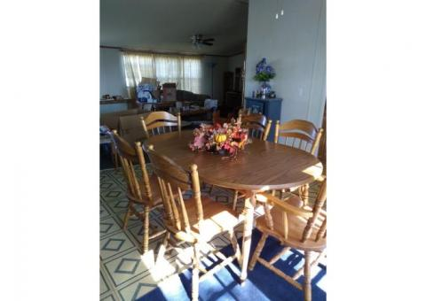 Oval dinning table, 6 chairs (2 are captains), 2 leafs
